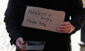 A homeless person begging