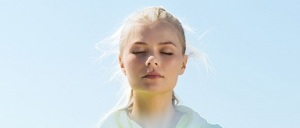 Girl-meditating-with-blue-background-cropped and resized